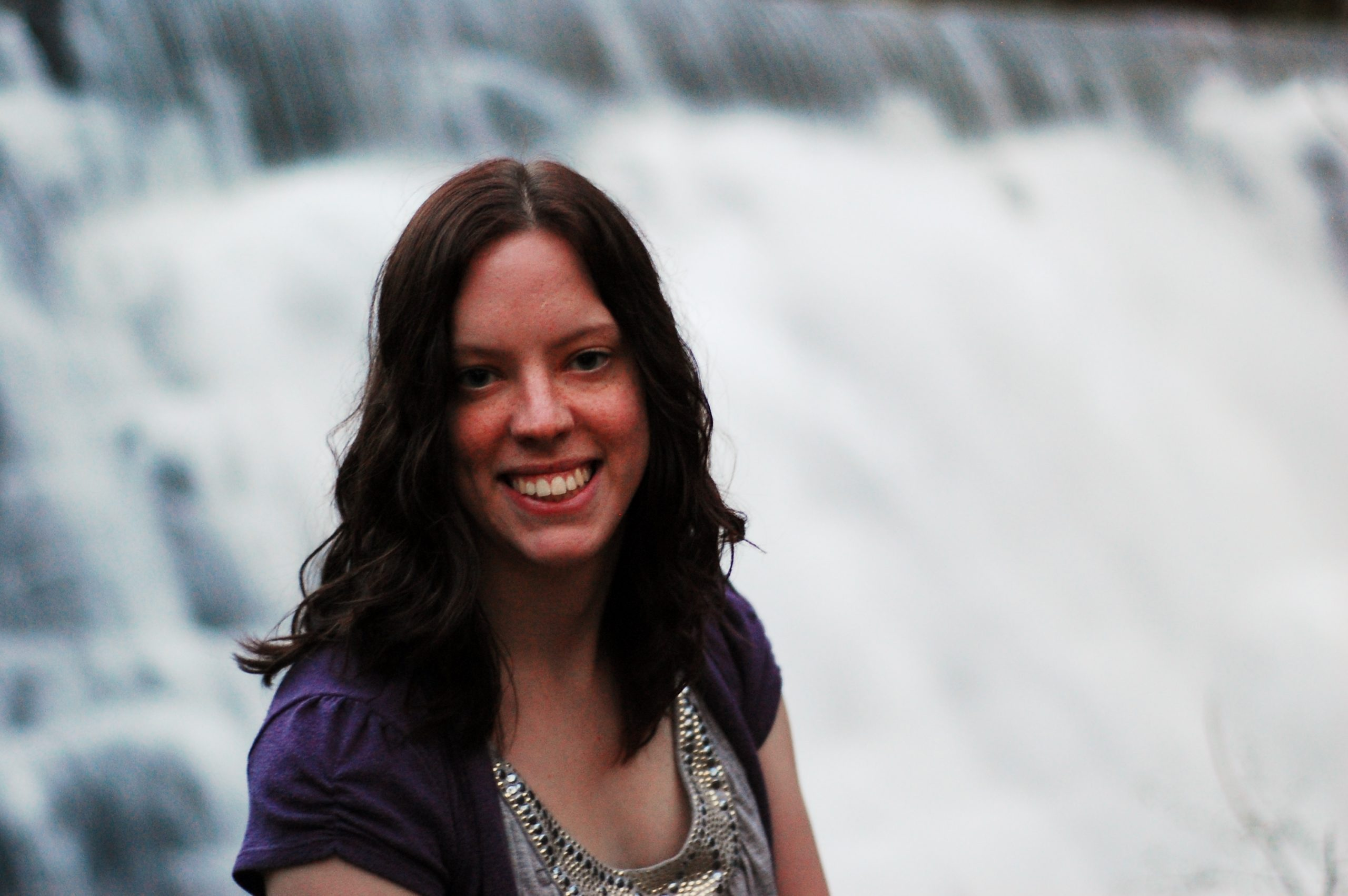 Photo of Amelia Hall in front of a waterfall